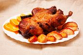 picture of roast duck  - Photo of roast duck with apples and oranges - JPG