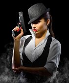 picture of girls guns  - Young girl with gun on black - JPG