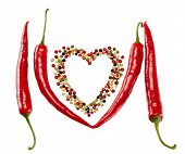 foto of peppercorns  - Red hot peppers in pods and colorful mixture of peppercorns concept of love - JPG