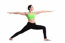 picture of virabhadrasana  - Sporty girl on white background doing lunge exercise Warrior II posture Virabhadrasana 2 - JPG