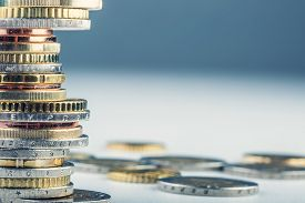 stock photo of treasury  - Euro coins. Euro money. Euro currency.Coins stacked on each other in different positions.