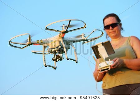 PILSEN CZECH REPUBLIC - JULY 4, 2015:Unidentified photographer piloting drone quadrocopter Dji Phantom 3 Professional with high resolution digital camera. New tool for aerial photo and video.