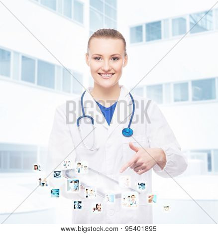 Young, professional and cheerful doctor woman with an ipad. Medical technology and futuristic medicine concept.