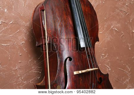 Cello on brown wall background