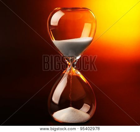 Hourglass on dark color background