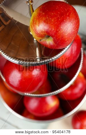 Tasty ripe apples on serving tray close up