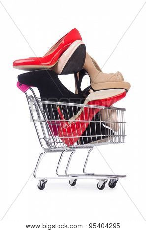 Woman shoes in shopping cart on white