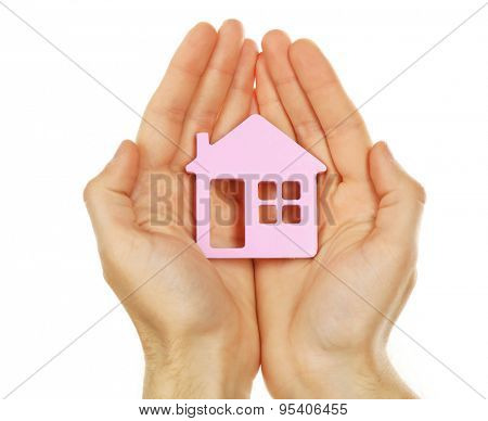 Female hands holding house isolated on white