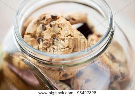 food, junk-food, culinary, baking and eating concept - close up of chocolate oatmeal cookies in glass jar