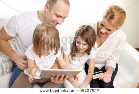 family, online shopping, technology and people - happy family with tablet pc computer and credit card at home