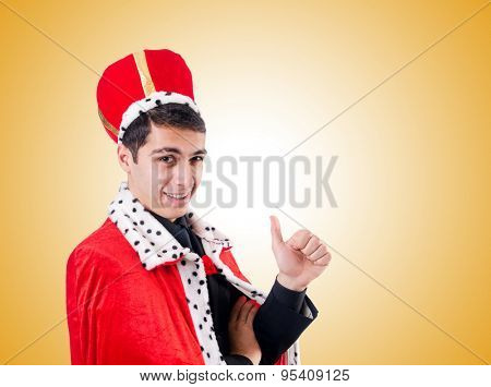 Businessman playing king against the gradient