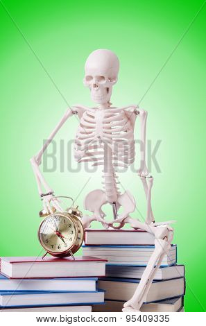 Skeleton reading books against gradient