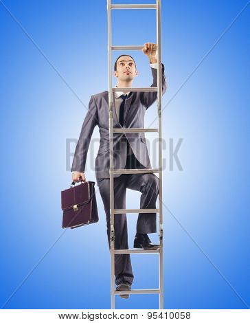 Businessman climbing the ladder against the gradient