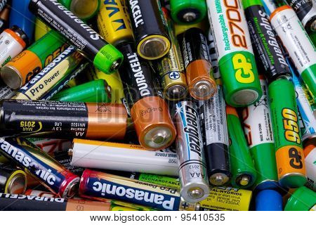 BUDAPEST, HUNGARY - MAY 22, 2015: Many used AA and AAA sized batteries in a pile.