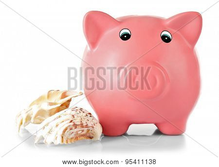 Piggy bank with shells isolated on white