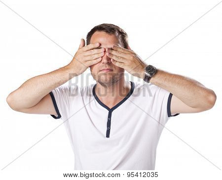 Young man put his hands over eyes isolated on white background