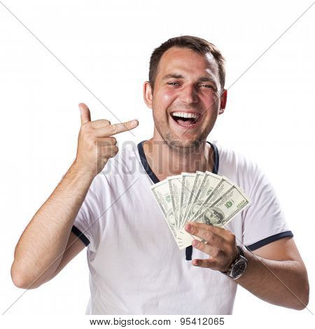 Happy young man holding a pile of cash isolated on white background