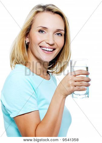 The Young Woman Holds A Glass With Water