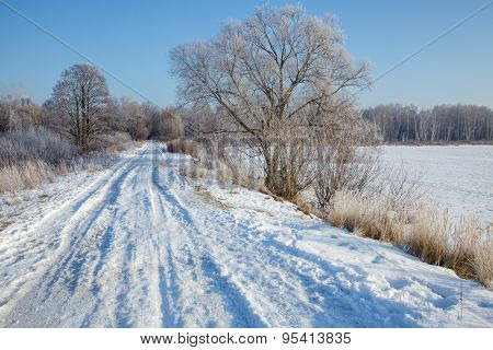 Snowy country road on a sunny winter day