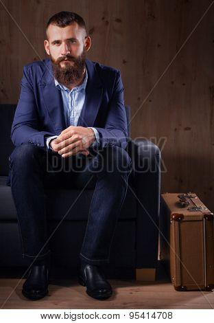 Businessman sitting on sofa in office lobby