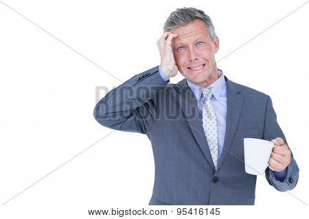 businessman drinking cup of coffee before work on white background