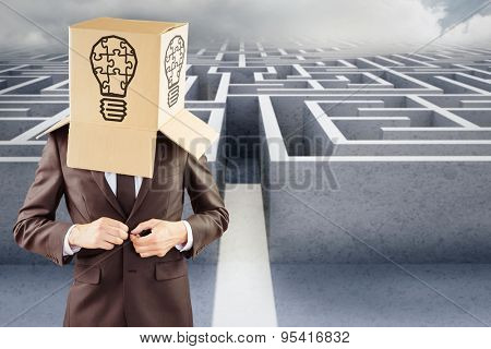 Anonymous businessman buttoning his jacket against big 3d maze under clouds