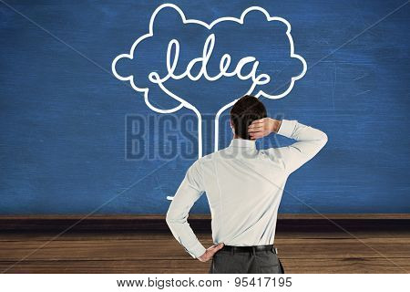 Thinking businessman with hand on head against blue room