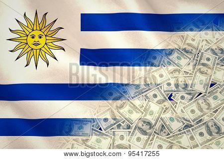 Pile of dollars against digitally generated uruguay national flag