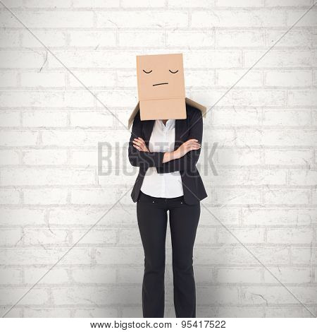 Businesswoman with box over head against white wall