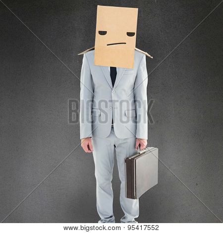 Anonymous businessman against grey room