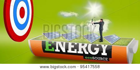 Businessman shooting a bow and arrow against solar panels in a sunny field in an energy saving battery