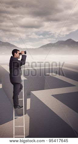 Businessman standing on ladder against cloudy sky over maze