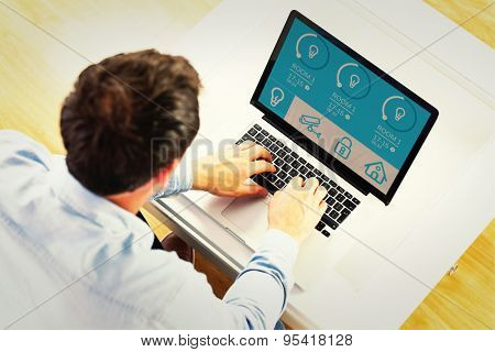 Man using laptop against home automation system