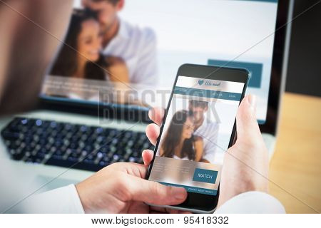 Businessman using smartphone against dating website
