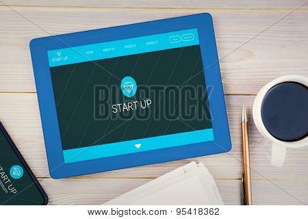 homepage against tablet on desk