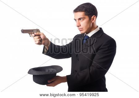 Young elegant man holding handgun isolated on white