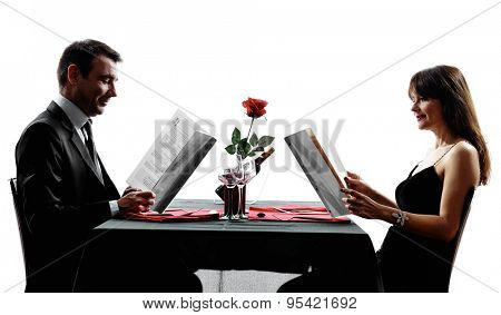 couples lovers dinning reding menu in silhouettes on white background