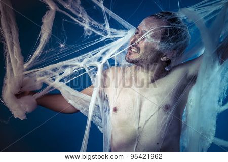 Silk, naked man trapped in a huge spider web