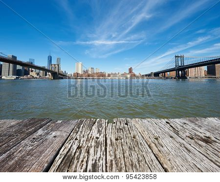 Manhattan skyline view from Brooklyn between Brooklyn Bridge and Manhattan Bridge in New York City