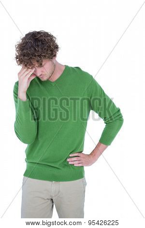 Sad casual man standing in front of camera on white background