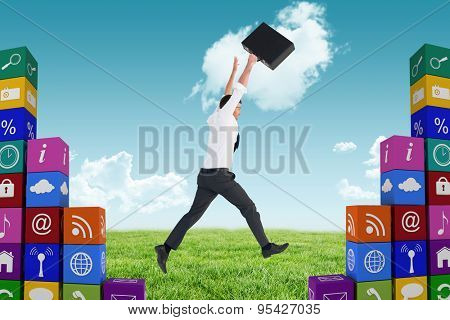 Businessman leaping with his briefcase against blue sky over green field