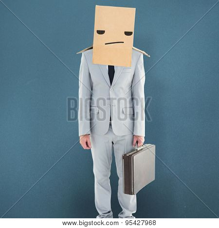 Anonymous businessman against blue background