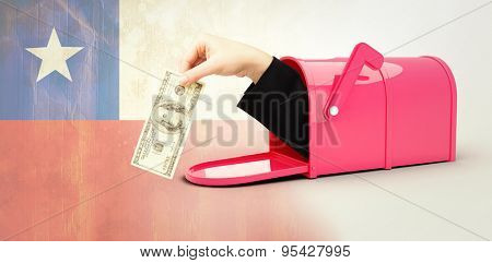 Businesswomans hand holding hundred dollar bill against chile flag in grunge effect