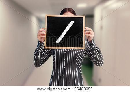 Businesswoman showing board against college hallway