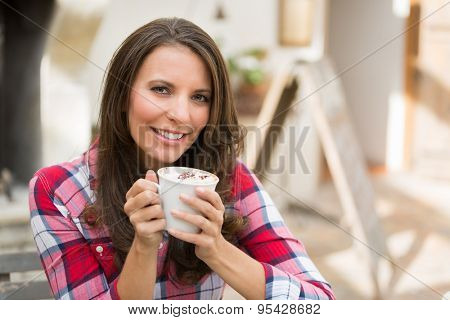 Beautiful smiling woman drinking coffee