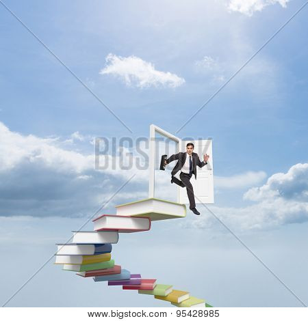 Stern businessman in a hurry against blue sky