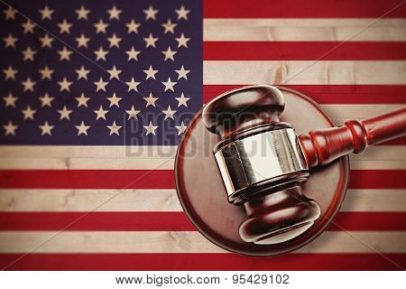 Hammer and gavel against bleached wooden planks background