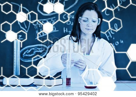 Science graphic against beautiful scientist focusing on her experimentation