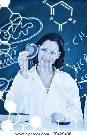 Science graphic against cute scientist looking at a petri dish