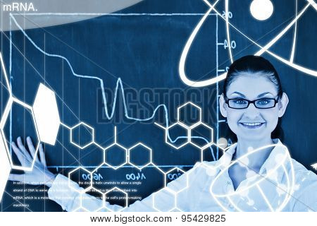 Science graphic against scientist showing a graph on the blackboard